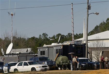 Law enforcement officials continue to man a command center set up at Destiny Church near the scene of a shooting and hostage taking that happened five days ago near Midland City, Alabama February 3, 2013. REUTERS/Phil Sears