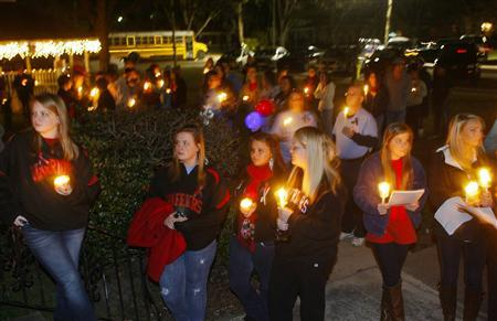 Over a hundred people gathered at City Hall for a candlelight vigil in Midland City, Alabama, January 31, 2013. The vigil honored the memory of bus driver Charles Poland, and showed support for the release of a five-year-old boy held hostage in a bunker by Poland's alleged killer. REUTERS/Phil Sears