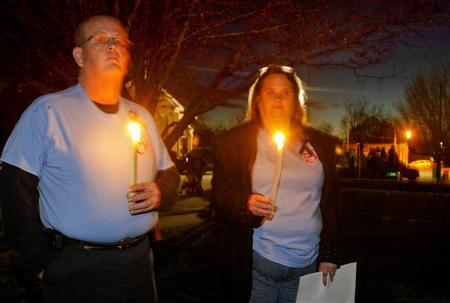 Mark Jackson and Renae Douglas take part in a candlelight vigil at City Hall in Midland City, Alabama, January 31, 2013. The vigil honored the memory of bus driver Charles Poland, and showed support for the release of a five-year-old boy held hostage in a bunker by Poland's alleged murderer. REUTERS/Phil Sears
