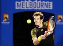 Andy Murray of Britain hits a return to Novak Djokovic of Serbia during their men's singles final match at the Australian Open tennis tournament in Melbourne January 27, 2013. REUTERS/Daniel Munoz