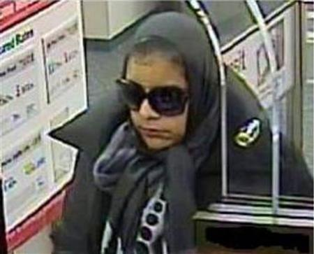 An unknown bank robber is pictured on a surveillance camera inside a bank in Washington, in this February 4, 2013 FBI handout photo. REUTERS/FBI/Handout