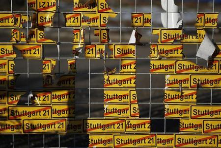 Protest stickers are attached to the fence at the construction site of the controversial transport development project ''Stuttgart 21'' in Stuttgart February 5, 2012.