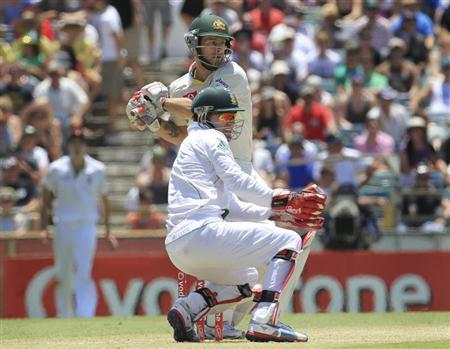 Australia's Matthew Wade (top) hits a shot as South Africa's AB de Villiers watches at the WACA in Perth during the second day's play of the third test cricket match December 1, 2012. REUTERS/Stringer