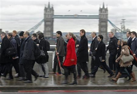 People walk past Tower Bridge during rush hour in the financial district of the City of London January 29, 2013. REUTERS/Luke Macgregor