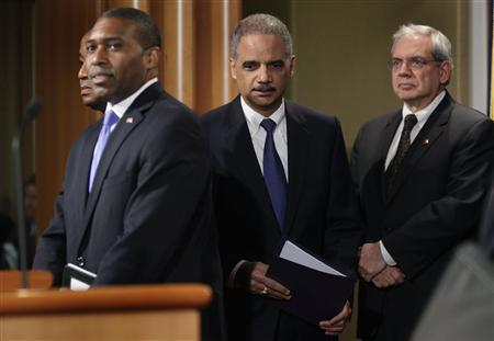 U.S. Attorney General Eric Holder (C) arrives at a joint news conference to announce a major financial fraud enforcement action at the Justice Department in Washington February 5, 2013. REUTERS/Yuri Gripas