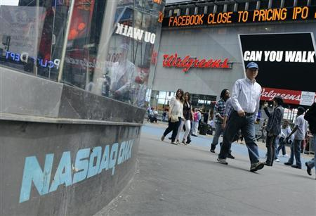 News of the Facebook IPO is seen on the Times Square news scroller across from the Nasdaq Market site in New York, May 17, 2012. REUTERS/Keith Bedford