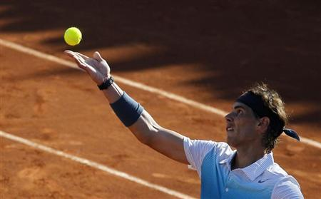 Rafael Nadal of Spain serves during his men's doubles tennis match with Juan Monaco of Argentina, against Frantisek Cermak and Lukas Dlouhy of Czech Republic at the Chilean Open tennis tournament in Vina del Mar city, about 121 km (75 miles) northwest of Santiago, February 5, 2013. REUTERS/Eliseo Fernandez