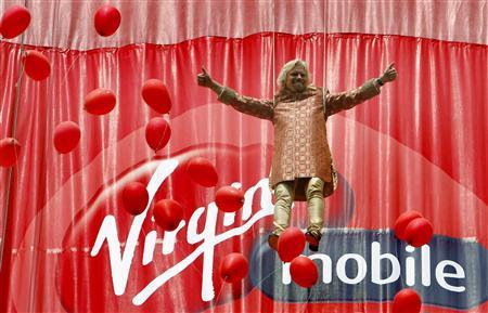 Virgin Group Chairman Richard Branson is seen dangling on a rope to unveil the Virgin Mobile logo in Mumbai in this March 2, 2008 file photograph. REUTERS/Punit Paranjpe/Files
