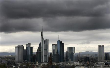 The skyline of Frankfurt with its bank towers under dark clouds is seen from the construction site of the new headquarters of the European Central Bank (ECB) during a guided tour in Frankfurt, April 26, 2012. REUTERS/Kai Pfaffenbach (GERMANY - Tags: BUSINESS POLITICS)