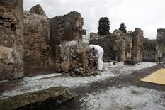 A restorer works in the ancient Roman city Pompeii, which was buried in AD 79 by an eruption of the Vesuvius volcano, February 6, 2013. The European Union launched a multi-million euro restoration of the crumbling world heritage site on Wednesday, and said it would seek to protect it from the influence of local mafia. REUTERS/Ciro De Luca