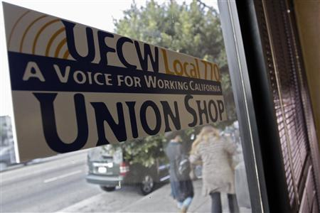 A United Food and Commercial Workers union (UFCW) Local 770 Union Shop sticker is pictured in the window at the Venice Beach Care Center in Los Angeles, California February 6, 2013. REUTERS/Jonathan Alcorn