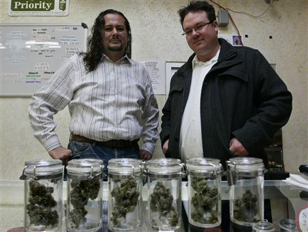 Rigo Valdez (L), an organizing director with United Food and Commercial Workers union (UFCW), and Brennan Thicke, a founder of the Venice Beach Care Center, pose together at the medical marijuana dispensary in Los Angeles, California, February 6, 2013. REUTERS/Jonathan Alcorn