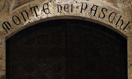 The entrance of Monte Dei Paschi bank headquarters is pictured in Siena January 24, 2013. At the news conference on February 7, 2013, European Central Bank (ECB) President Mario Draghi can expect to be asked how much he knew about the derivatives scandal at Monte Paschi, and what he did about it when he headed Italy's central bank from 2006 to 2011. Picture taken January 24, 2013. REUTERS/Stefano Rellandini