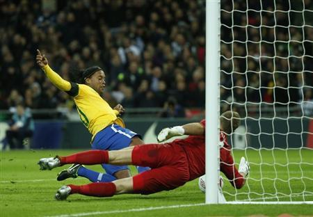England's goalkeeper Joe Hart (R) makes a double penalty save against Brazil's Ronaldinho during their international friendly soccer match at Wembley stadium in London February 6, 2013. REUTERS/Eddie Keogh