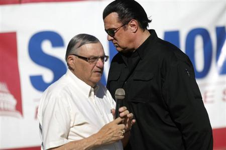 Maricopa County Sheriff Joe Arpaio (L) is introduced by actor Steven Seagal during a campaign rally in Mesa, Arizona October 27, 2012. REUTERS/Joshua Lott/Files