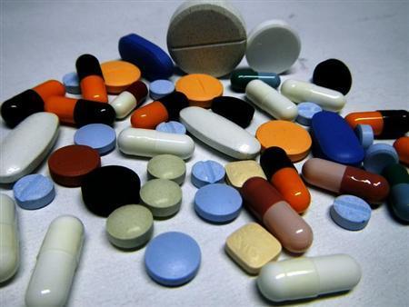 Various medicine pills are seen in Ljubljana February 14, 2012. REUTERS/Srdjan Zivulovic/Files