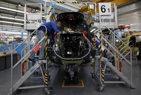 A technician works on the production line of Super-Puma helicopters at the European civil and military helicopter manufacturer Eurocopter in Marignane, December 17, 2012. REUTERS/Jean-Paul Pelissier/Files