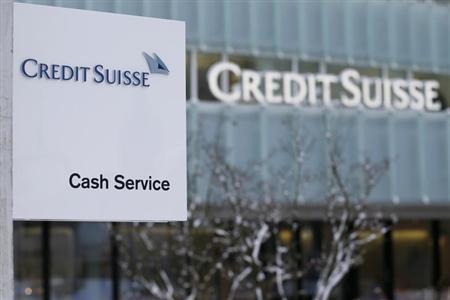 Credit Suisse logo on a cash machine is seen outside a Credit Suisse office building in Guemligen near Bern February 7, 2013.