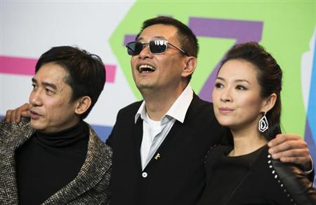 Actor Tony Leung Chiu Wai, director Wong Kar Wai and actress Zhang Ziyi (L-R) pose after a news conference to promote the movie Yi Dai Zong Shi, ''The Grandmaster'' at the 63rd Berlinale International Film Festival in Berlin February 7, 2013. REUTERS/Thomas Peter