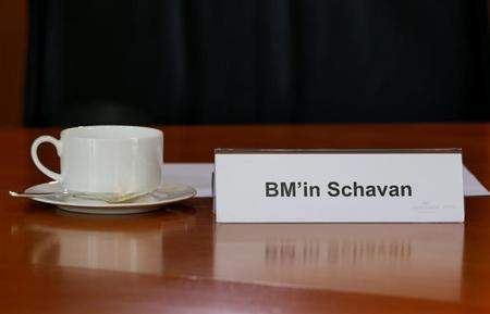 The name sign of German Education Minister Annette Schavan is pictured in front of her empty cup before the cabinet meeting at the Chancellery in Berlin, February 6, 2013. Chancellor Angela Merkel's education minister was stripped of her doctorate on Tuesday for alleged plagiarism in her work, a move that could embarrass the German leader as she seeks election to a third term in office. REUTERS/Fabrizio Bensch (GERMANY - Tags: POLITICS)