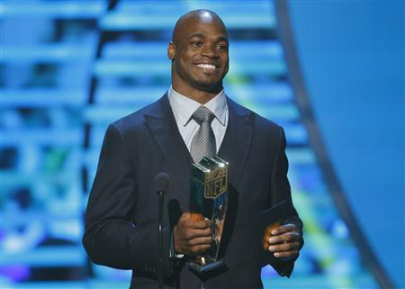 Minnesota Vikings running back Adrian Peterson accepts the NFL MVP award during the NFL Honors awards show in New Orleans, Louisiana February 2, 2013. REUTERS/Jeff Haynes