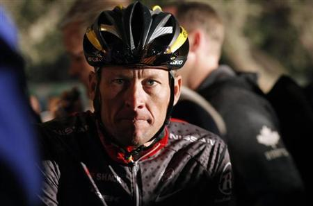 Lance Armstrong awaits the start of the 2010 Cape Argus Cycle Tour in Cape Town March 14, 2010. REUTERS/Mike Hutchings/Files