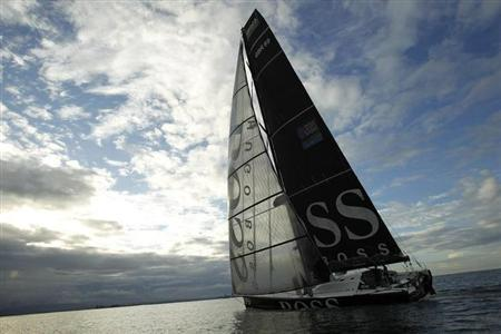 Monohull ''Hugo Boss'', skippered by Britain's Alex Thomson and Spain's Guillermo Altadill, arrives in second place in the Jacques Vabre Transat yacht race from Le Havre, France to Puerto Limon, west of San Jose, November 18, 2011. REUTERS/Juan Carlos Ulate (COSTA RICA - Tags: SPORT YACHTING)