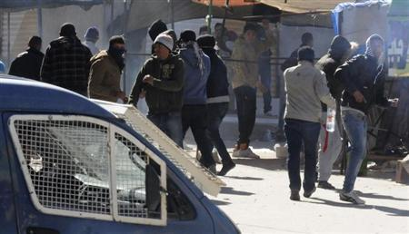 Protesters take part in a demonstration in Gafsa February 7, 2013. REUTERS/Stringer
