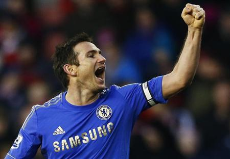 Chelsea's Frank Lampard celebrates a second own goal from Stoke City's Jonathan Walters during their English Premier League soccer match at the Britannia Stadium in Stoke-on-Trent, northern England, January 12, 2013. REUTERS/Darren Staples/Files