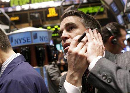 Traders work on the floor of the New York Stock Exchange March 18, 2009. REUTERS/Brendan McDermid
