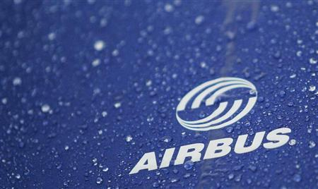 Water drops are pictured on an umbrella with Airbus logo during a protest in front of the Airbus facility in the northern German town of Varel March 1, 2007. REUTERS/Hannibal Hanschke