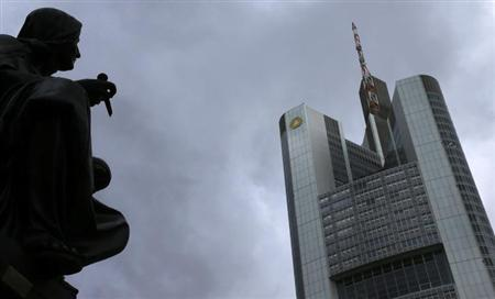 Dark clouds are seen over the head quarters of Germany's Commerzbank in Frankfurt, February 5, 2013. Commerzbank will publish its annual figures during a news conference next week. REUTERS/Kai Pfaffenbach (GERMANY - Tags: BUSINESS)