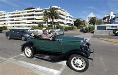 A man drives his 1935 Ford A through the streets of the luxurious seaside resort of Punta del Este February 4, 2013. REUTERS/Andres Stapff