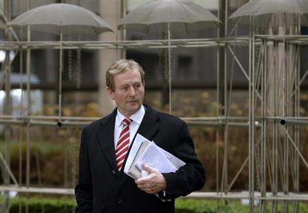 Ireland's Prime Minister Enda Kenny leaves for a break during an European Union leaders summit meeting discussing the European Union's long-term budget in Brussels February 8, 2013. REUTERS/Eric Vidal