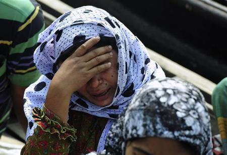 A relative of a missing passenger mourns after a ferry carrying more than 50 people sank in Munshiganj February 8, 2013. REUTERS/Khurshed Rinku