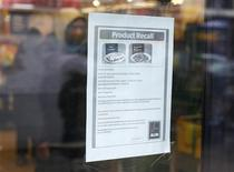 A recall notice for frozen meals which had tested positive for horse meat is seen at an Aldi supermarket in northwest London February 9, 2013. REUTERS/Suzanne Plunkett