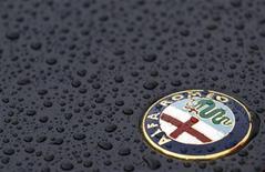The Alfa Romeo logo is seen on an Alfa Romeo Spider during an Alfa Romeo classic car meeting in Fiuggi, south of Rome, June 9, 2012. REUTERS/Max Rossi