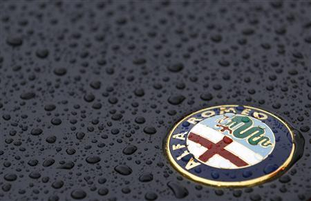 The Alfa Romeo logo is seen on an Alfa Romeo Spider during an Alfa Romeo classic car meeting in Fiuggi, south of Rome, June 9, 2012. REUTERS/Max Rossi