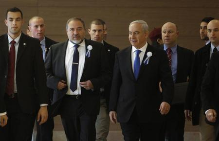 Israel's Prime Minister Benjamin Netanyahu and former foreign minister Avigdor Lieberman (3rd L) arrive to a Likud-Beitenu faction meeting at parliament in Jerusalem February 5, 2013. REUTERS/Baz Ratner