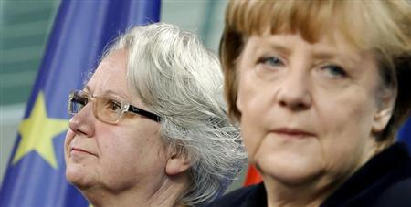 German Chancellor Angela Merkel (R) and Education Minister Annette Schavan arrive for a statement to the media in Berlin February 9, 2013. Germany's education minister resigned on Saturday after being stripped of her doctorate over plagiarism charges, an embarrassment for her close confidante Chancellor Angela Merkel who is campaigning to win a third term in office this year. REUTERS/Tobias Schwarz (GERMANY - Tags: POLITICS)
