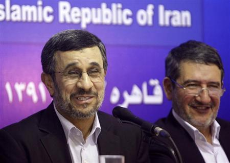 Iran's President Mahmoud Ahmadinejad (L) talks during a news conference at the end of his visit to Cairo, February 7, 2013. REUTERS/Asmaa Waguih (EGYPT - Tags: POLITICS)