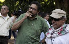 """Revolutionary Armed Forces of Colombia's (FARC) lead negotiator Ivan Marquez smokes a Cohiba cigar next to FARC negotiator Jesus Santrich (R) after a conference in Havana February 10, 2013. Colombia and the Marxist FARC rebels said on Sunday their talks aimed at ending half a century of conflict are picking up pace and making progress towards an agreement on land reform, a key point in the peace process. Speaking as they ended their latest round of negotiations in the Cuban capital, they signalled that public acrimony they had displayed in recent weeks did not represent what was happening behind closed doors. Rodrigo Granda, a senior leader of the FARC, said the discussions were moving ahead on the """"right track"""" and """"at the speed of a bullet train."""" REUTERS/Enrique De La Osa (CUBA - Tags: POLITICS CIVIL UNREST)"""