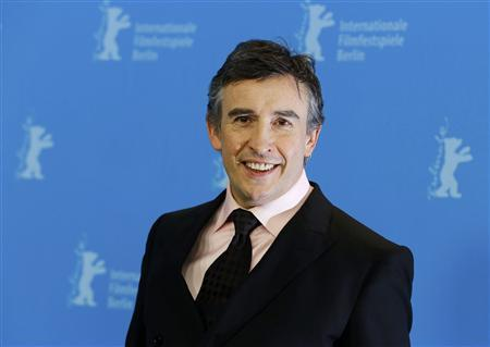 Actor Steve Coogan poses during a photocall to promote the movie ''The Look of Love'' at the 63rd Berlinale International Film Festival in Berlin February 10, 2013. REUTERS/Thomas Peter
