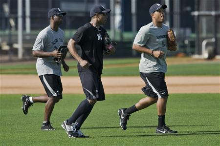 New York Yankees outfielders (from L) Melky Mesa, Curtis Granderson and Thomas Neal take to the field during an informal workout at the team's minor league training complex in Tampa, Florida, February 11, 2013. REUTERS/Steve Nesius