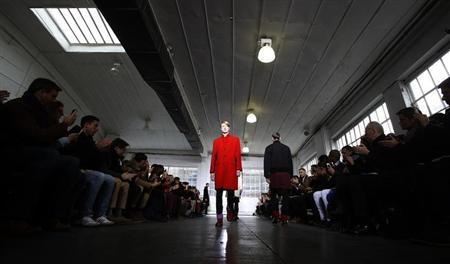 A model presents a creation from the Duckie Brown Autumn/Winter 2013 collection during New York Fashion Week in New York, February 7, 2013. REUTERS/Carlo Allegri