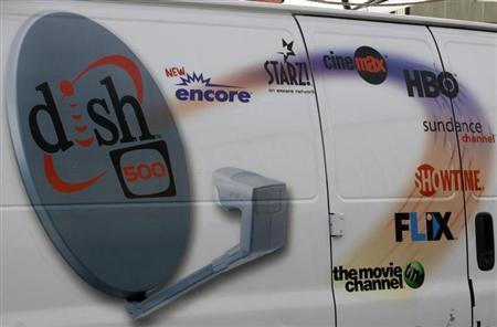 The Dish Network logo on the side of installers truck is seen in Denver March 2, 2009. REUTERS/Rick Wilking