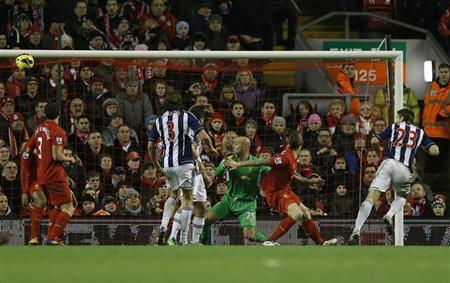 West Bromwich Albion's Gareth McAuley (R) heads to score against Liverpool during their English Premier League soccer match at Anfield in Liverpool, northern England February 11, 2013. REUTERS/Phil Noble