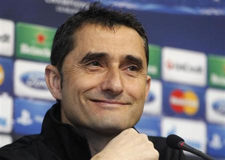 Valencia's coach Ernesto Valverde smiles during a news conference a day before their Champions League soccer match against Paris Saint-Germain in Valencia February 11, 2013. REUTERS/Heino Kalis