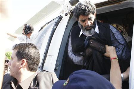 Muammar Gaddafi's former spy chief Abdullah al-Senussi (R) arrives in Tripoli September 5, 2012. REUTERS/Libyan National Guard/Handout/Files