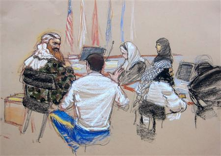 In this Pentagon-approved courtroom sketch, alleged 9/11 mastermind Khalid Sheikh Mohammad (L) confers with defense attorney Army Captain Jason Wright, after hearings convened for the day at the Guantanamo Bay U.S. Naval Base in Cuba February 11, 2013. REUTERS/MANDATORY CREDIT:Janet Hamlin
